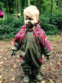 Muddy child enjoying themselves